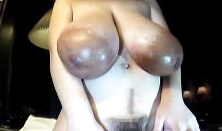 Sister in the kitchen of a woman wearing a bra under neon asian young porn lights